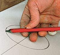 Using a pencil and a drywall nail as a compass