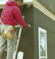 Snapping chalklines for corner boards and siding panels