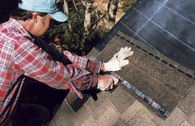 installing shingles on roof