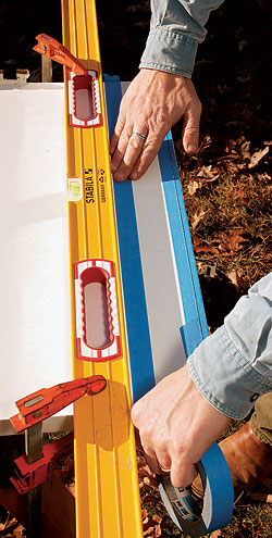 To avoid marring the door, put down two layers of tape next to the level