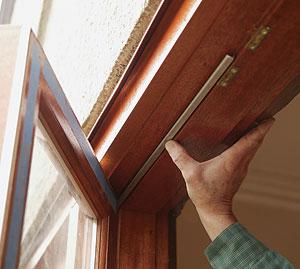 Lock strip interlock weatherstrip door